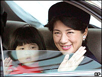 Japanese Crown Princess Masako, right, and her daughter, Princess Aiko, wave from the window of their limousine as they head to the Imperial Palace for a visit to Emperor Akihito on 01/01/2005