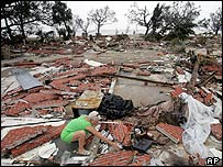 Woman sifts through rubble of her home in Gulfport