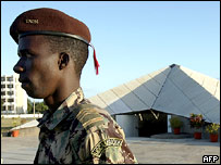 Soldier guards the tomb of ex-President Samora Machel and other liberation-era heroes.  AFP/Getty/Alexander Joe