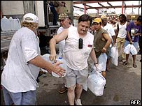 A man receives water and ice at a distribution point in Biloxi, Mississippi
