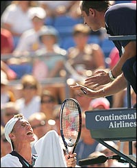 Lleyton Hewitt questions a call with the umpire during a tough second-round battle against Jose Acasuso