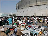 Hurricane Katrina survivors wait outside the Superdome and Convetion Center in New Orleans