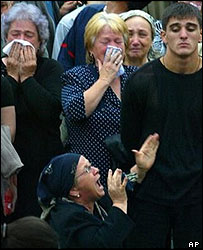 Relatives sob during the one minute silence in memory of the Beslan victims