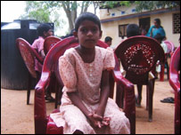 Susi Sinnathurai sits in a chair at the Tender Sprout home