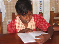 Shanthini Sivakumar with a book
