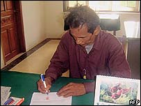 Yor Ngun signing a confession in March 2005