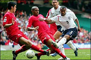 Ashley Cole (right) is closed down by Richard Duffy (left) and Danny Gabbidon