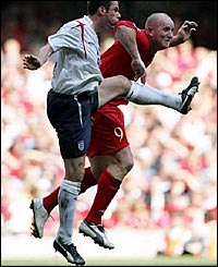 Jamie Carragher (left) beats John Hartson to a header