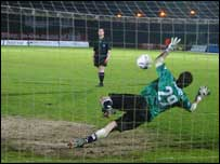 Brighton's keeper saves a Swindon penalty