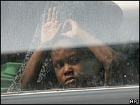 A young Hurricane Katrina victim looks out the window of a bus after she was evacuated from the Convention Centre in New Orleans