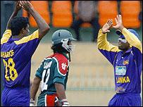 Sri Lanka's Farveez Maharoof (L) and Mahela Jayawardene (R) celebrate a dismissal