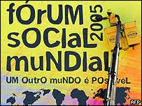 A workman cleans a World Social Forum sign in Porto Alegre, Brazil
