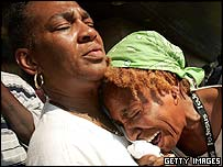 Women crying as they wait for evacuation from the Superdome