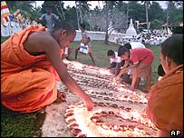 Buddhist monks light candles at Talpe, south of Colombo
