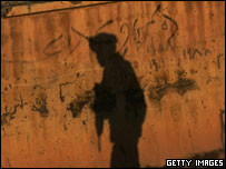 Shadow of an armed man in Iraq
