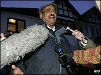 Azmat Begg leaving his house in Birmingham on Wednesday