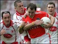 Paddy McKeever tries to break clear of Philip Jordan