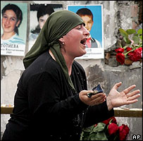 Woman cries in ruined school gymnasium in Beslan