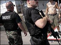 Armed policemen patrol New Orleans