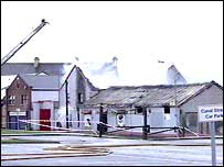 Smouldering remains of Strabane shop