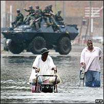 New Orleans residents wading through floodwaters