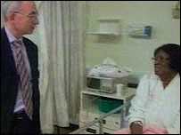 Dr Brian Gibbons and a patient at the Princess of Wales Hospital, Bridgend, on Wednesday