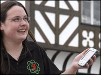 Student Awen Williams with one of the palm computers