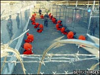 Razor wire and prisoners at Guantanamo Bay's Camp Delta