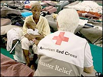 A Red Cross volunteer comforts a hurricane victim