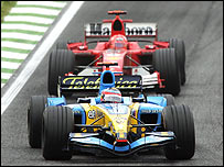 Fernando Alonso leads Michael Schumacher at the San Marino Grand Prix