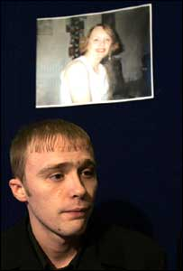 Allison McGarrigle's son Robert appears below her picture at a press conference in Glasgow