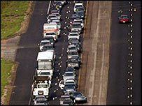 Caras wait to enter Jefferson Parish near New Orleans