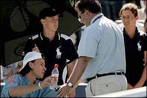 Official Mike Morrisey stands in front of Guillermo Coria (left) as he argues with Nicolas Massu