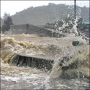 Splashing water from a sea which floods a road as a powerful typhoon approaches to the southern Japan in Naze, Amami Oshima Island, Monday, Sept 5, 2005.