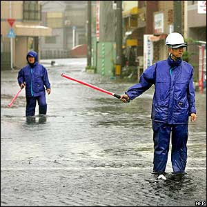 A flooded street is closed in Kagoshima, 06 September 2005.