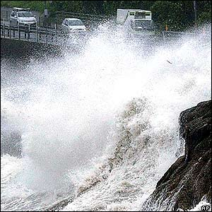 A huge wave smashes a national highway as a powerful typhoon approaches to the southern Japan in Kagoshima, Monday, Sept 5, 2005.