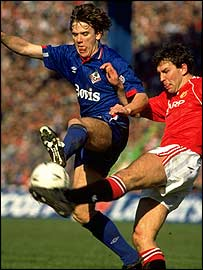 Nick Henry (left) holds off Bryan Robson