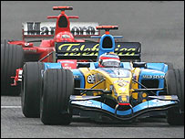 Fernando Alonso ahead of Michael Schumacher on his way to winning the San Marino Grand Prix
