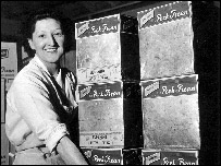 Kitty Williams carrying Peek Frean tins