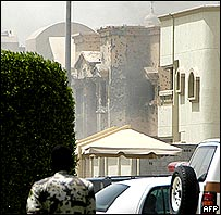 Saudi security officer watches besieged villa in Dammam