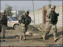 US troops move in after insurgents attacked a polling station in Ramadi