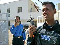 Iraqi policeman guards a polling station in Basra