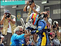 Renault team boss Flavio Briatore with Fernando Alonso after the Malaysian Grand Prix