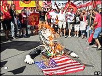 Protestors burn an effigy of Brazil's President Luiz Inacio Lula da Silva and the US flag