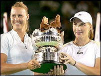 Alicia Molik and Svetlana Kuznetsova hold aloft the women's doubles trophy