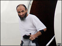 Australian Guantanamo Bay detainee Mamdouh Habib steps off a chartered jet as he arrives in Sydney, Australia, Friday, Jan. 28, 2005