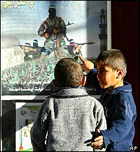 Children before Hamas poster in Gaza