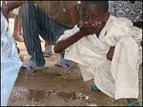 Child drinking rain water