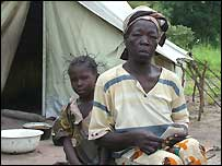 A mother and child outside their tent in Amboko camp, southern Chad