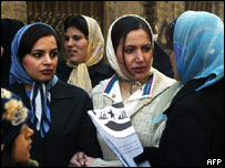Iraqi women queue outside a polling station in Tehran, Iran